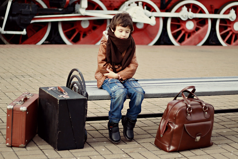 child with luggage