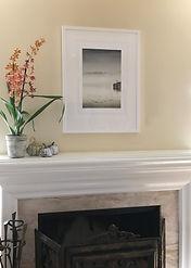 framed float mount wall art over fireplace