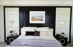 framed float mount wall art over bed