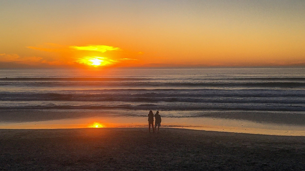 Poem reflects on 2020, while the sun sets over the ocean. Photographer and poet Kent Burkhardsmeier offers his 2020 reflections in a poem.