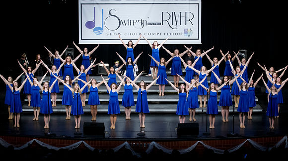 Show Choir Boys and girls singing on risers looking at the camera
