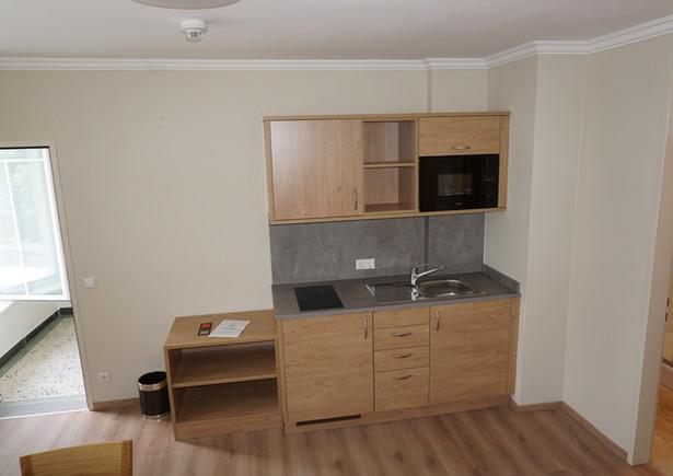 Kochnische in Dreibettzimmer