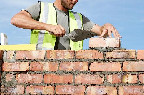 Builder-laying-bricks.jpeg