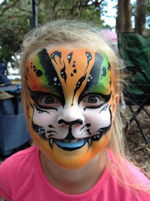 Rainbow tiger face paint design