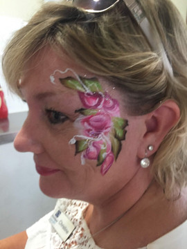 Rose blush face painting