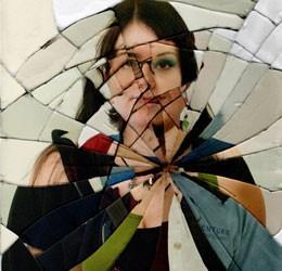 Woman Image in Broken Mirror