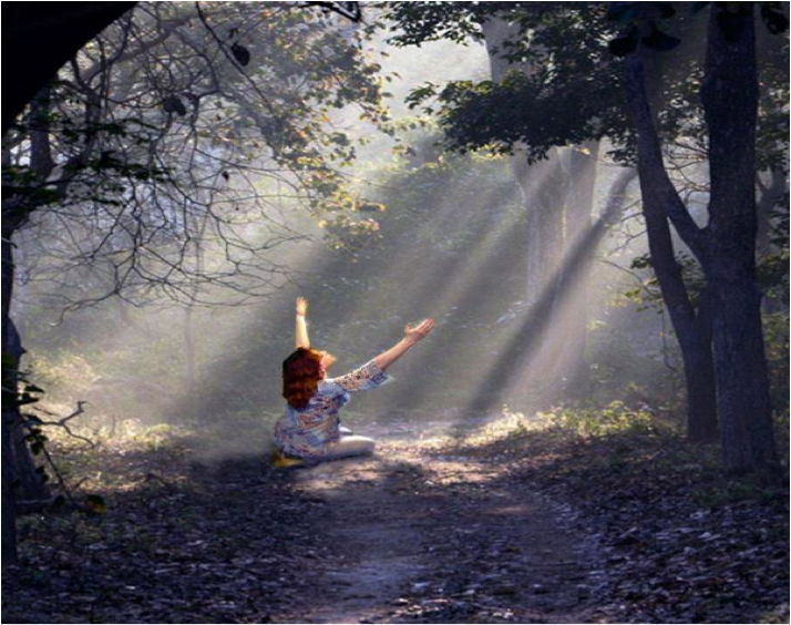 Girl in Forest Reaching Arms Towards the Heavens
