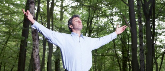 Man In Forest with Arms Stretched Out
