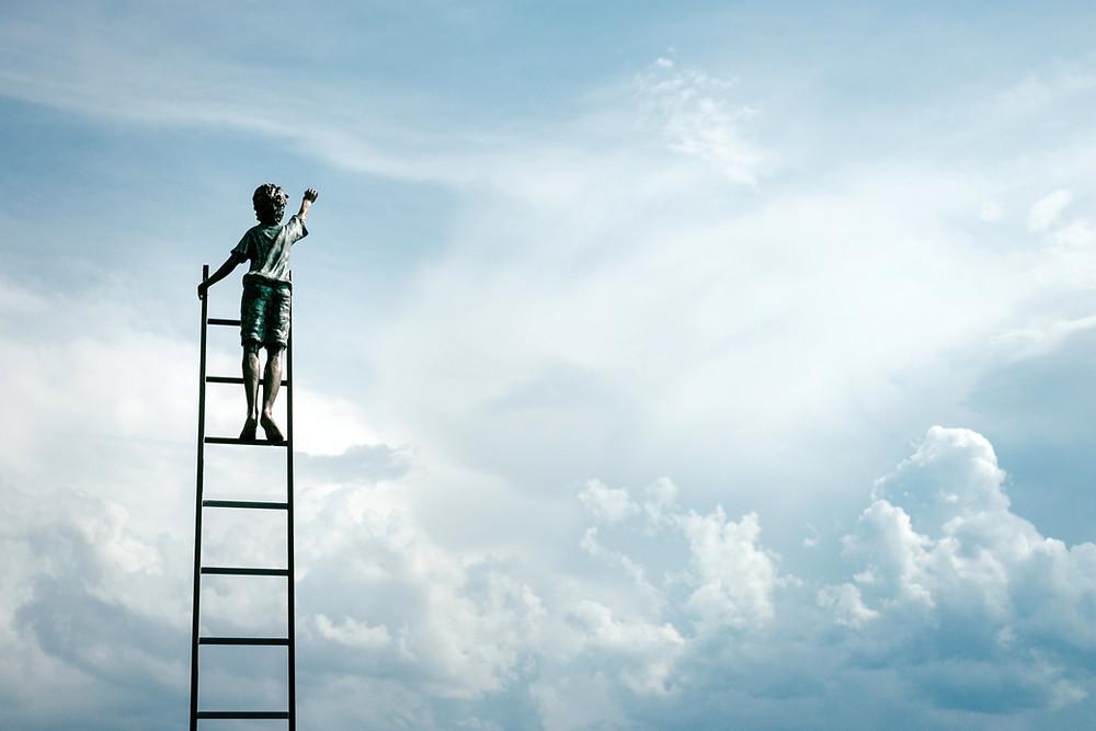 Individual Climbing Ladder Reaching Toward Sky