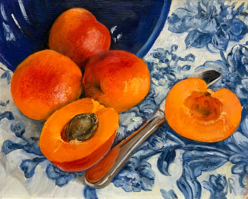 Apricots with blue bowl
