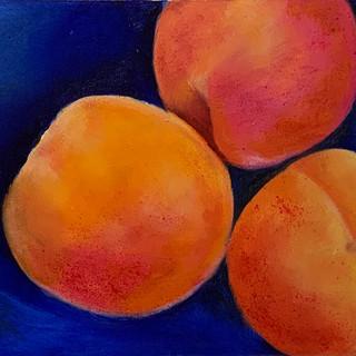 Apricots on blue