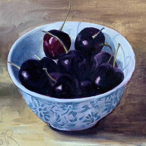 Cherries in a blue bowl