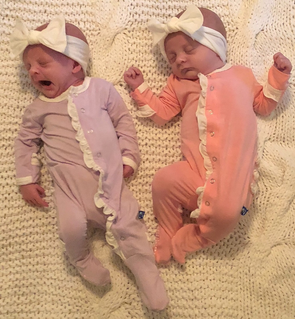 newborn twin girls on blanket
