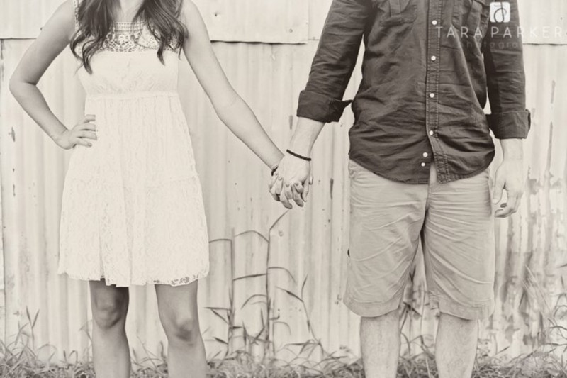 girl and boy holding hands engagement photo