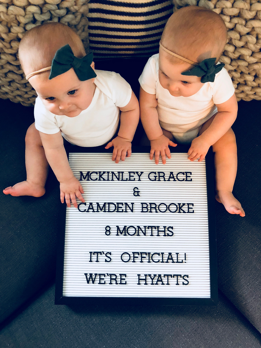 twin girl adoption announcement with sign