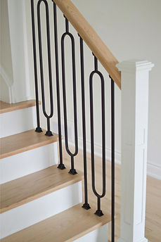 Modern Staircase Renovation with Wrought Iron Pickets by Azores Hardwood Flooring