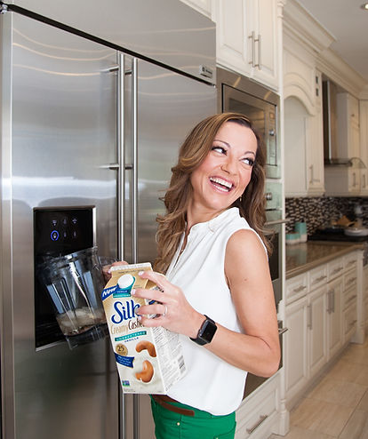 This is a Personal Brand Photography session with Viky Rose an entrepreneur and small business owner who is shown here during her photoshoot at her fridge in her home in the GTA