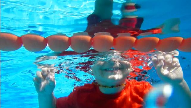 How does swimming break bad habits in children?