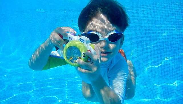 Taking photos of kids in the pool