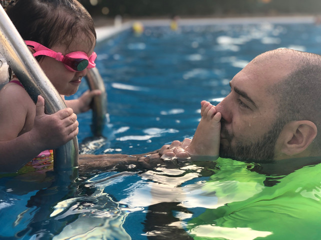 How can swimming help children with flat feet?
