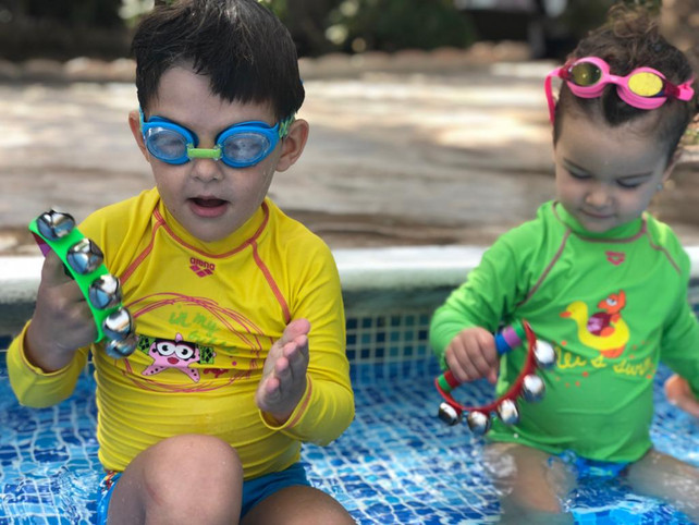 Why is music important for swimming with babies?
