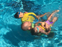 Why is it important that children start learning how to swim from the earliest age?