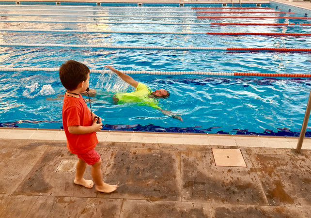 Who is teaching who how to swim?
