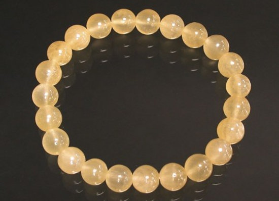 BRACELET DE PERLES EN CALCITE ORANGE 6 à 8 mm