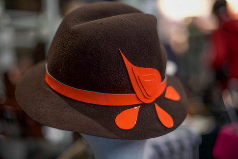 Brown felt trilby with orange paisley pattern detail