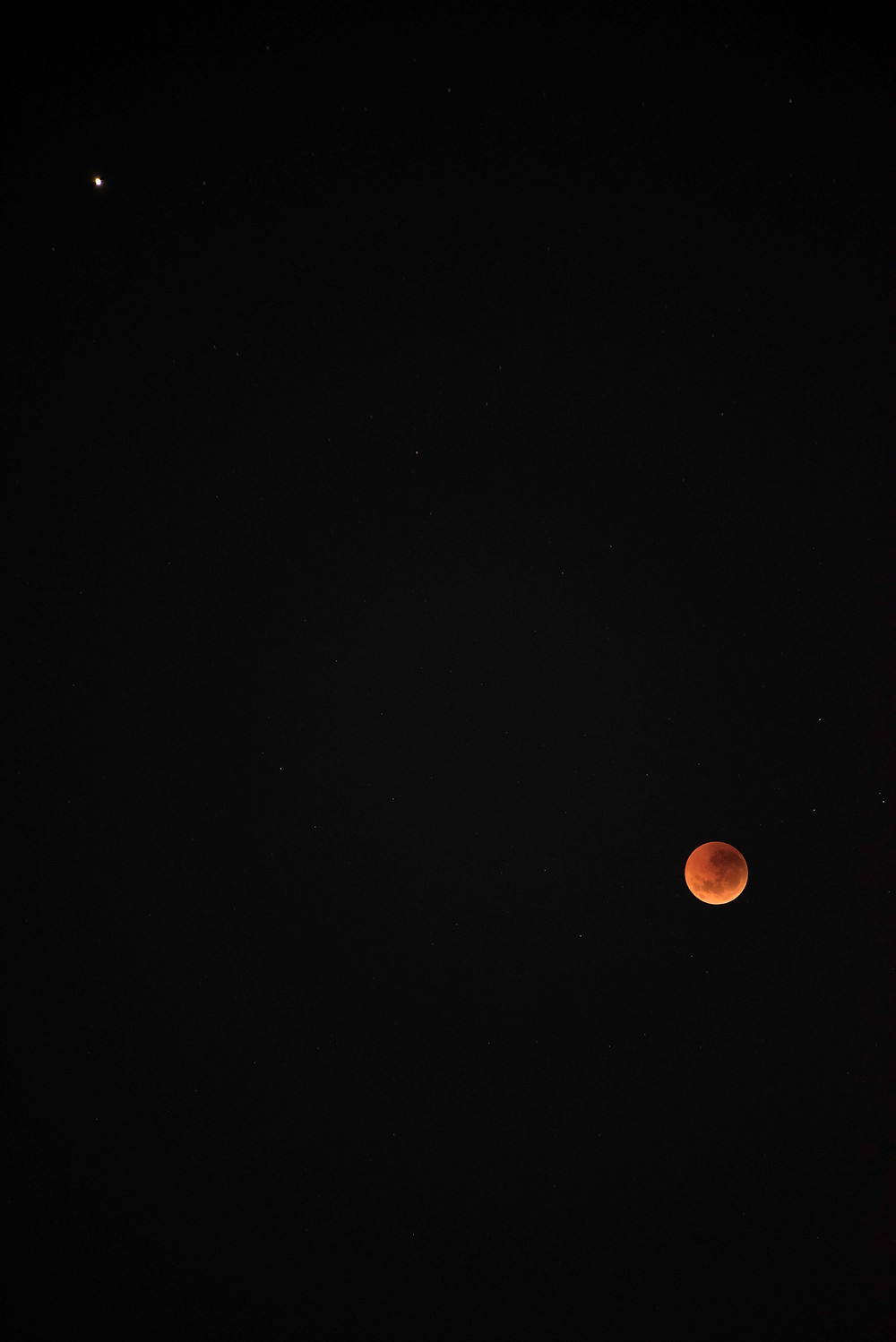 Moon and Mars. f/2.8, 0.6secs, iso 1600, 200mm (uncropped, unedited)
