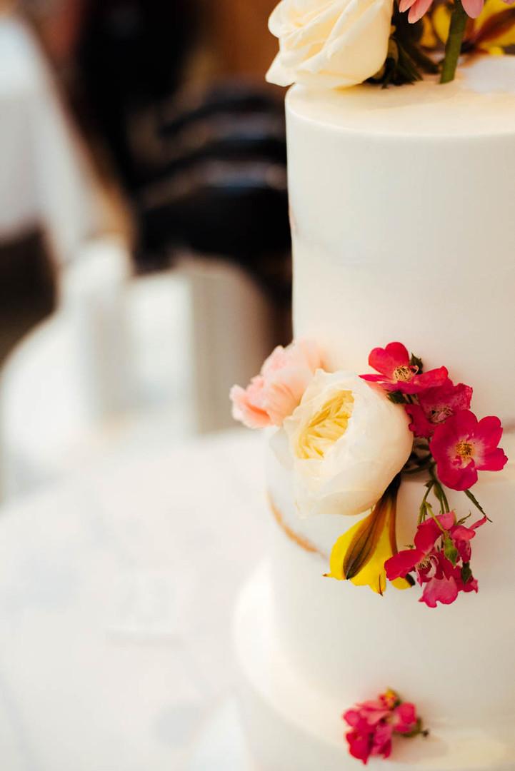 bright flowers white cake