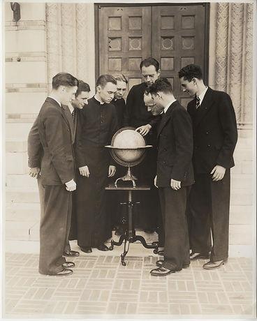 Seminarians studying globe, St. Edward S