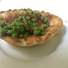 Home-made chunky beef pie and smashed peas