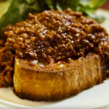 Bolognese on toast and salad
