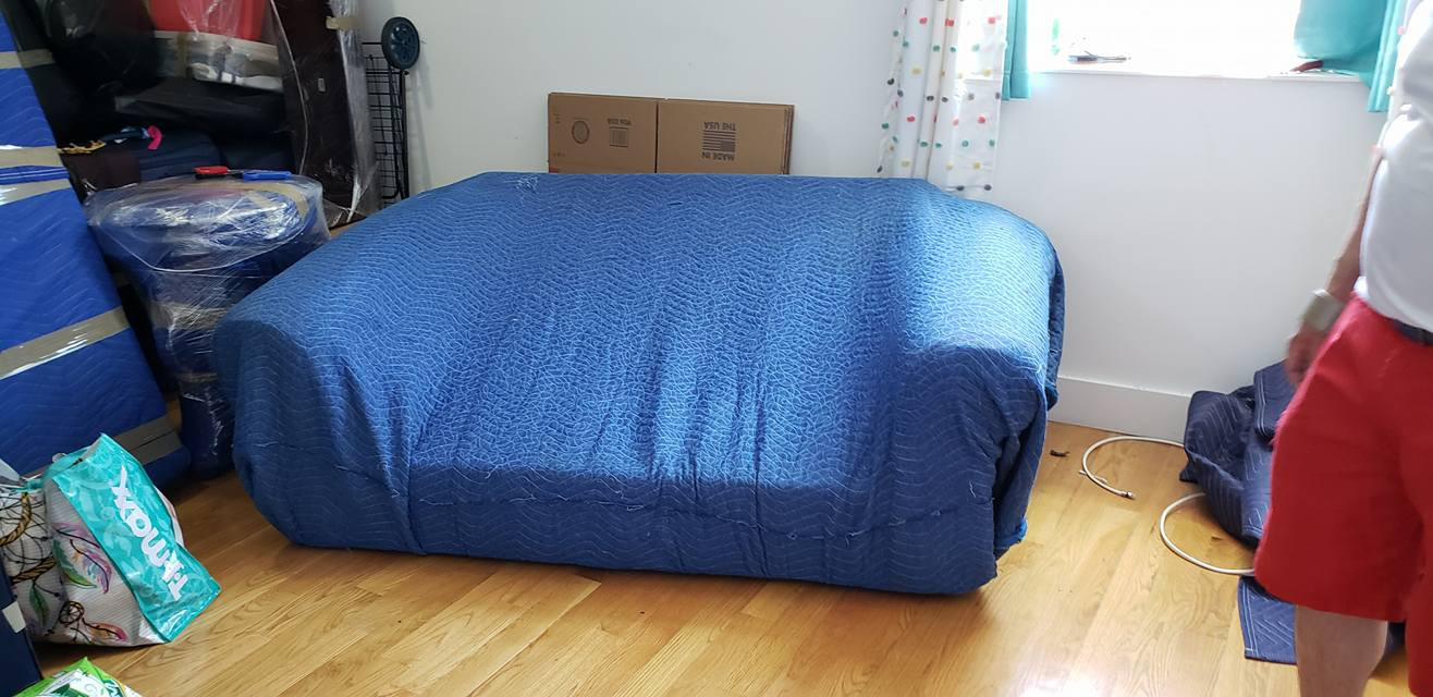 We use only professional moving tools like this sofa blanket!