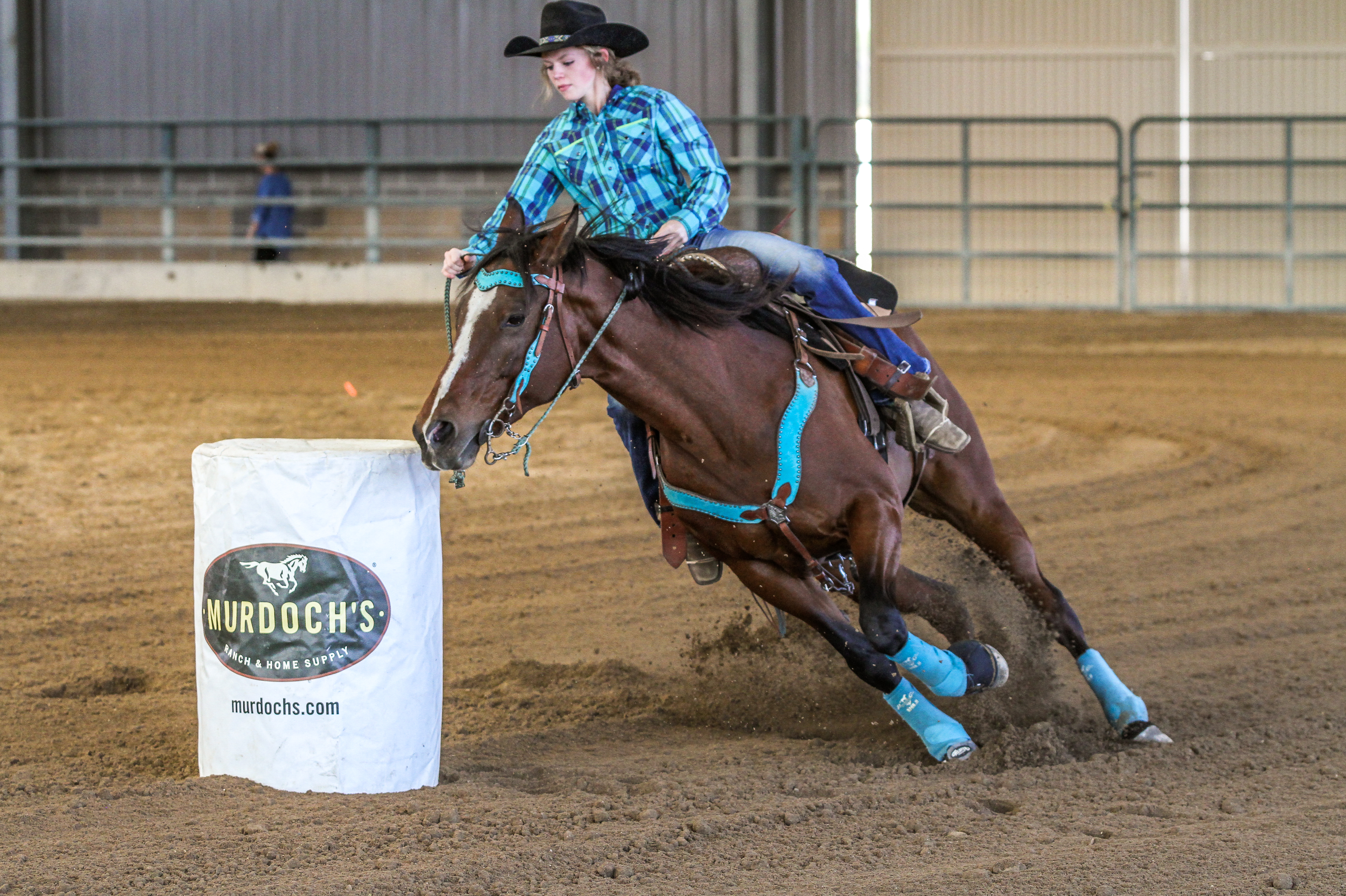 One of Brittnee's students competing at a barrel event
