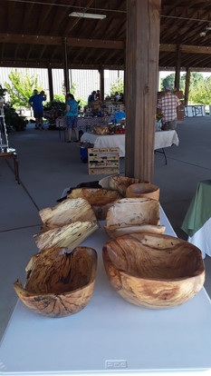 Collection of Wood Bowls on Display at Farmview Market
