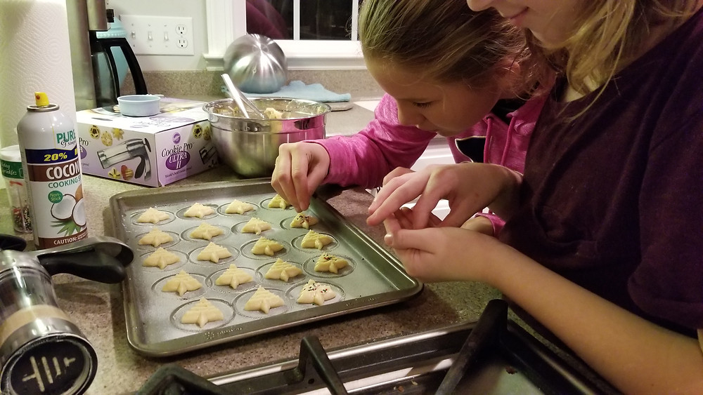My 12yo daughter and her friend making spritz cookies.