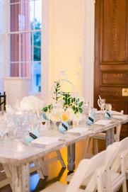 "<img src=""weddingtable.jpeg"" alt=""white wash wedding table, rustic wedding, blue napkins wedding, farm tables wedding, white folding chairs wedding"">"
