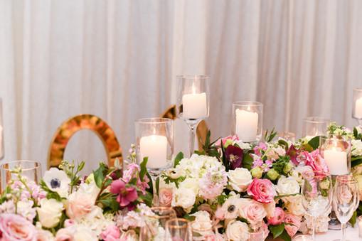 "<img src=""floralrunnerwedding"" alt=""pink wedding flowers, wedding floral runner, long wedding centerpieces, fancy wedding tablescape, formal wedding table, gold rim glassware wedding, blush wedding"">"