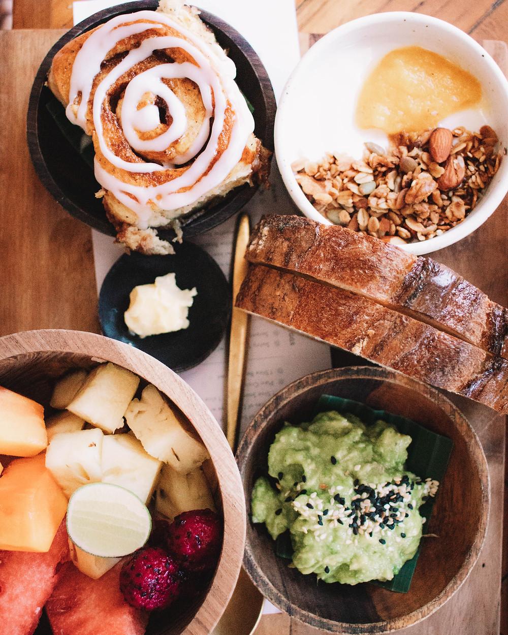 copenhagen canggu brunch cafe cinnamon roll fruit bread