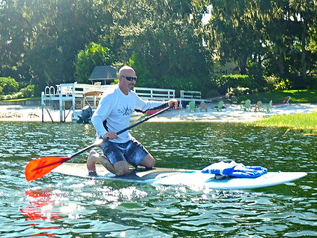 learning how to paddle board in lake county, Florida