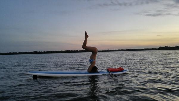 paddle board yoga poses