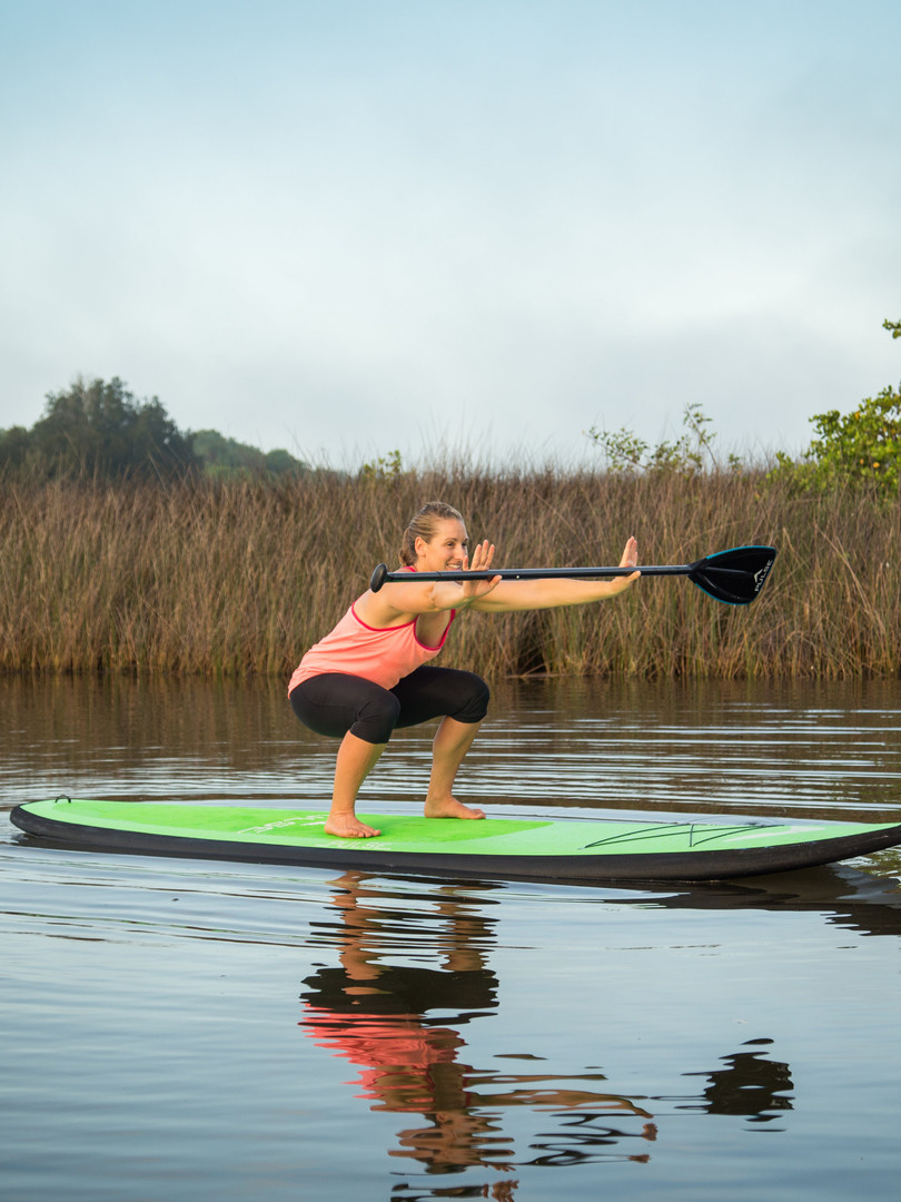 paddle board fitness squats