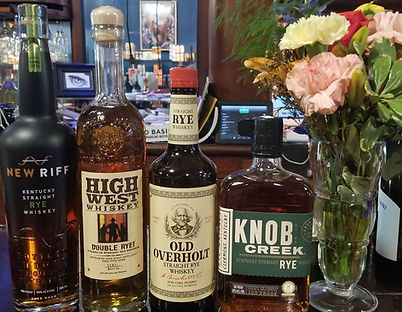 This is an image of some of the Whisky available near Notre Dame at The Brass Eye in Niles, Michigan. The brands shown are High West Distilling, New Riff, Old Overholt, and Knob Creek. These particular whiskys are all rye whiskeys available near Notre Dame.