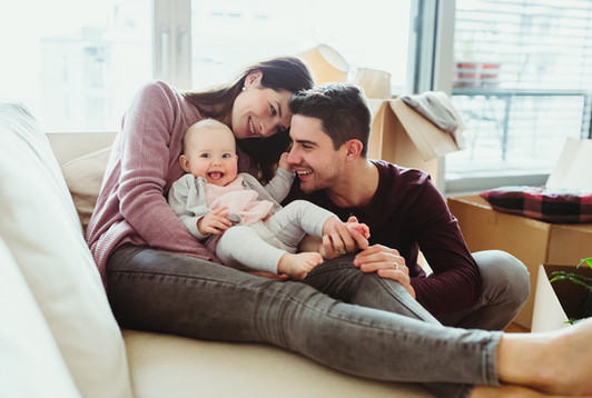 a-portrait-of-young-couple-with-a-baby-a