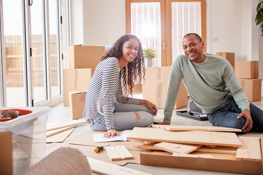 portrait-of-couple-in-new-home-on-moving