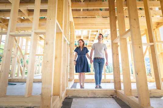 loving-couple-at-construction-site-of-th