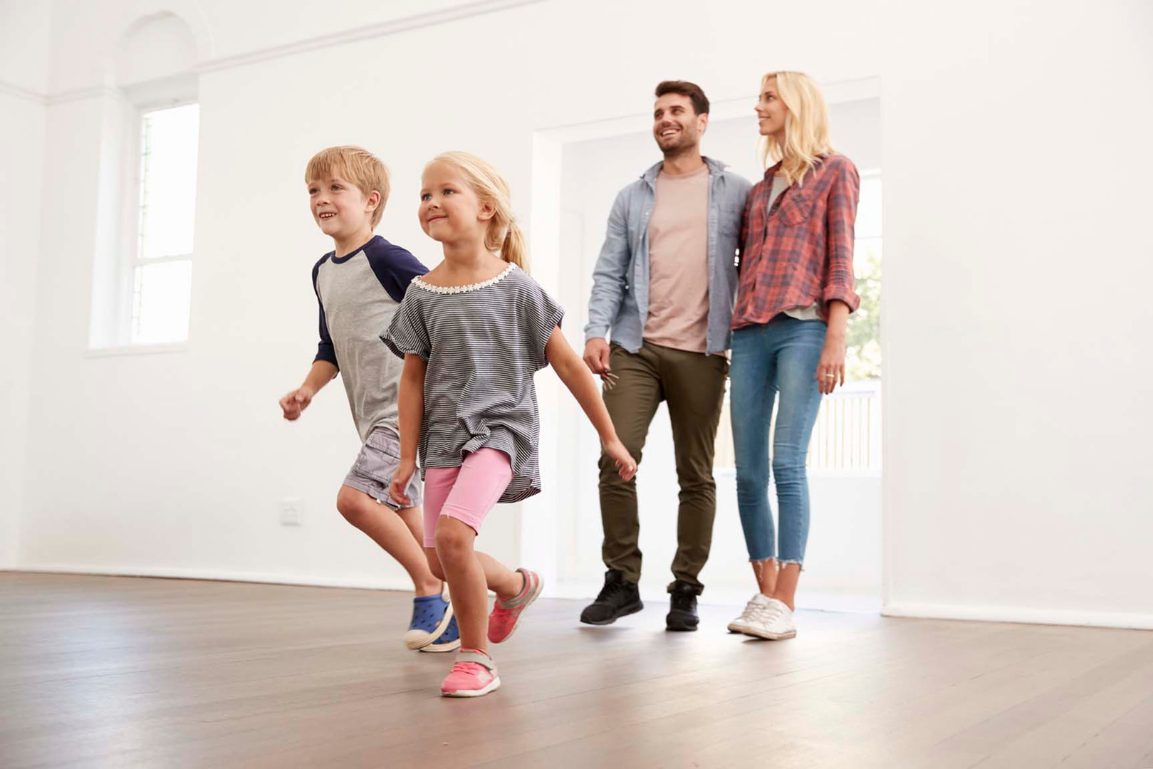 excited-family-explore-new-home-on-movin
