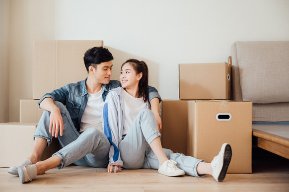 young-couple-moving-boxes-in-new-home-88